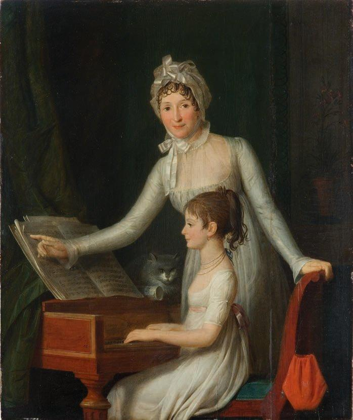 Woman teaching child to play spinet as cat watches
